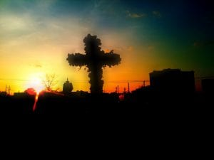 Sunrise in front of a cross during Easter